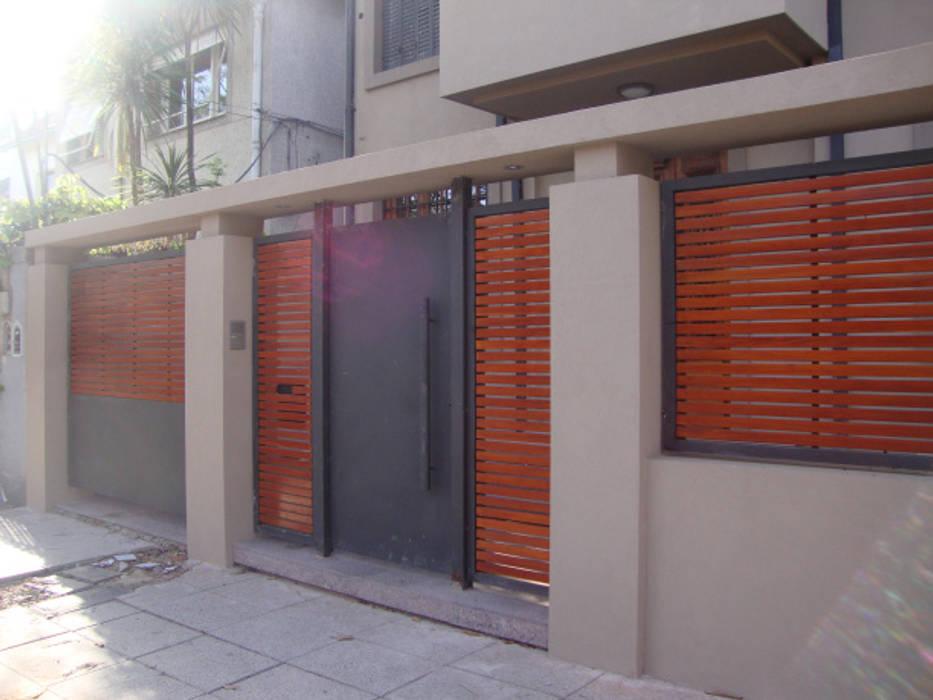 REMODELACION Y PUESTA EN VALOR CASA EN VICENTE LOPEZ Casas modernas: Ideas, imágenes y decoración de ARQUITECTA MORIELLO Moderno