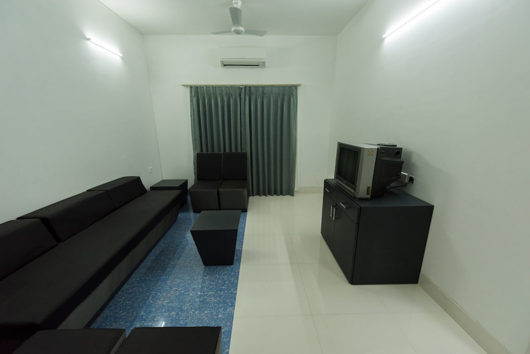 Lounge for general seating requirement:  Media room by Ankit Goenka