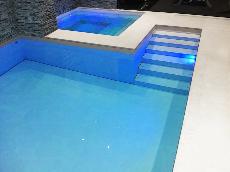 Luxury Pool with a Moving Floor : modern Pool by London Swimming Pool Company