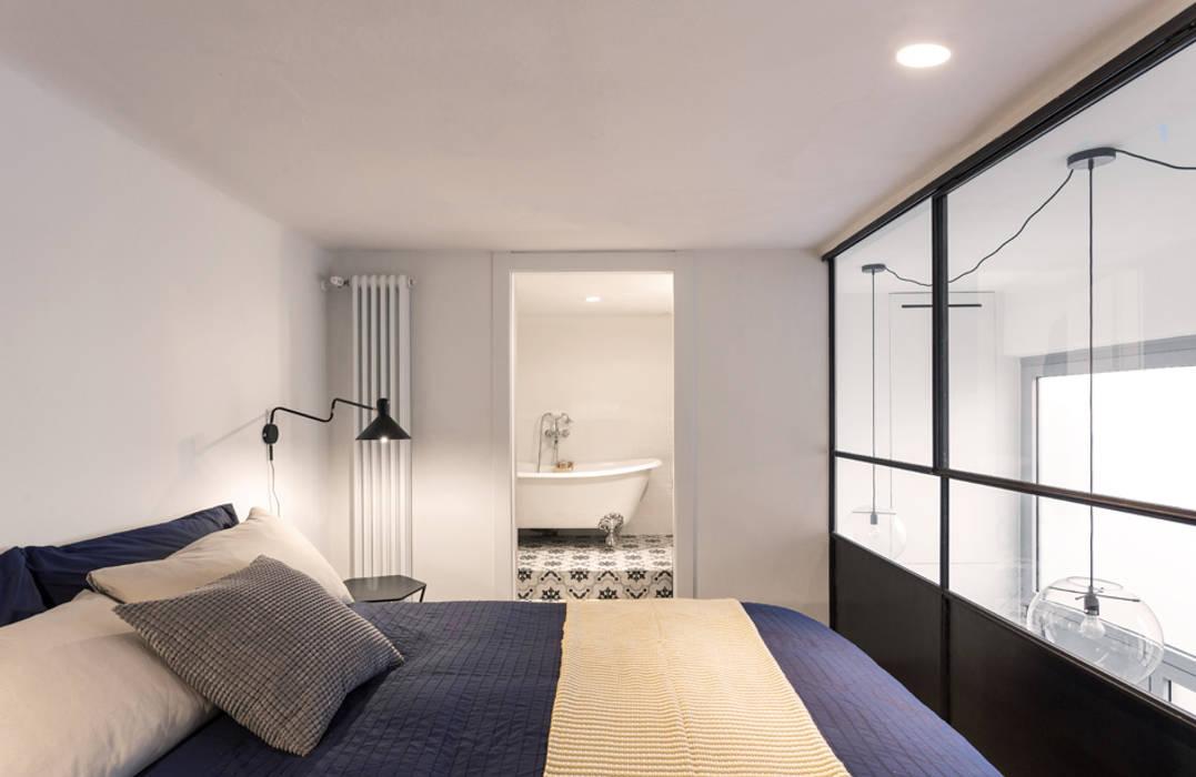 Dormitorios de estilo  de NOMADE ARCHITETTURA E INTERIOR DESIGN,