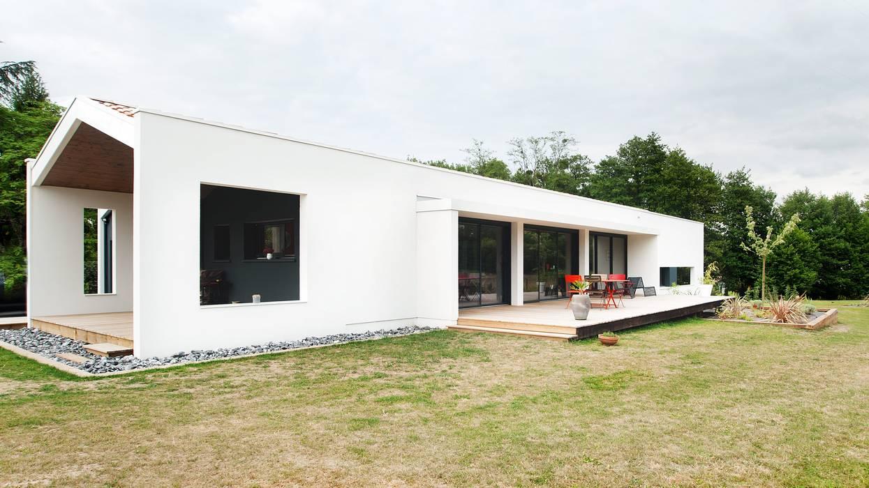 Rumah oleh Plus Architectes, Modern