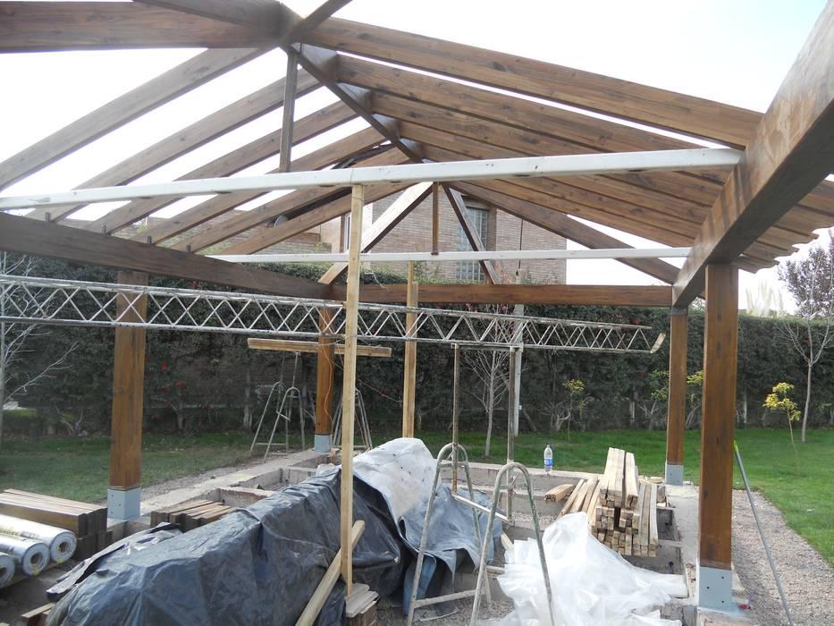 Construcción espacio: Jardines de estilo  por Hornero Arquitectura y Diseño,Clásico Madera Acabado en madera