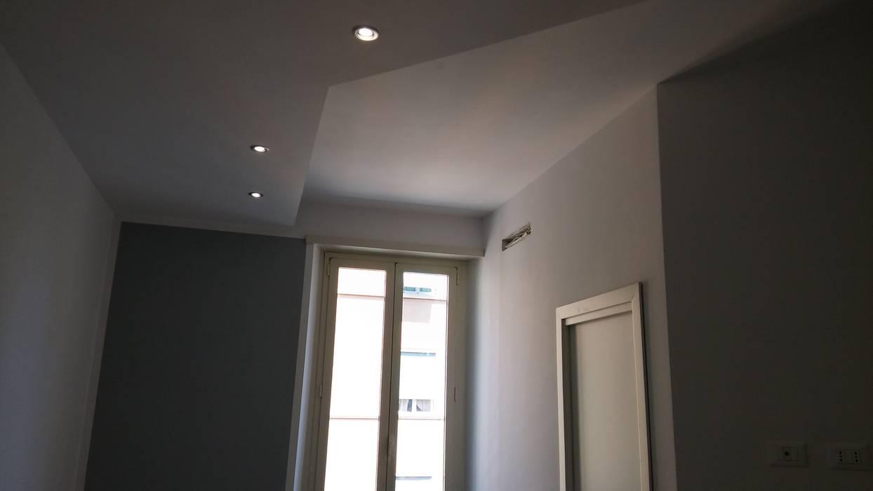 RISTRUTTURAZIONE APPARTAMENTO 2- post operam: Camera da letto in stile in stile Moderno di HAPPY HABITAT - STUDIO DI ARCHITETTURA SABRINA AURELI