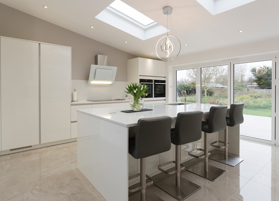 White moden kitchen in Hertfordshire by John Ladbury and Company.:  Kitchen by John Ladbury and Company