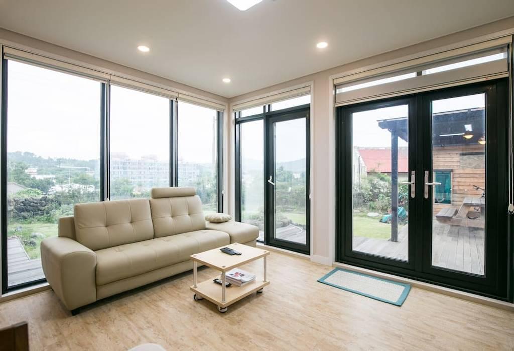 Modern Living Room by MetaPhora Co.,LTD Modern