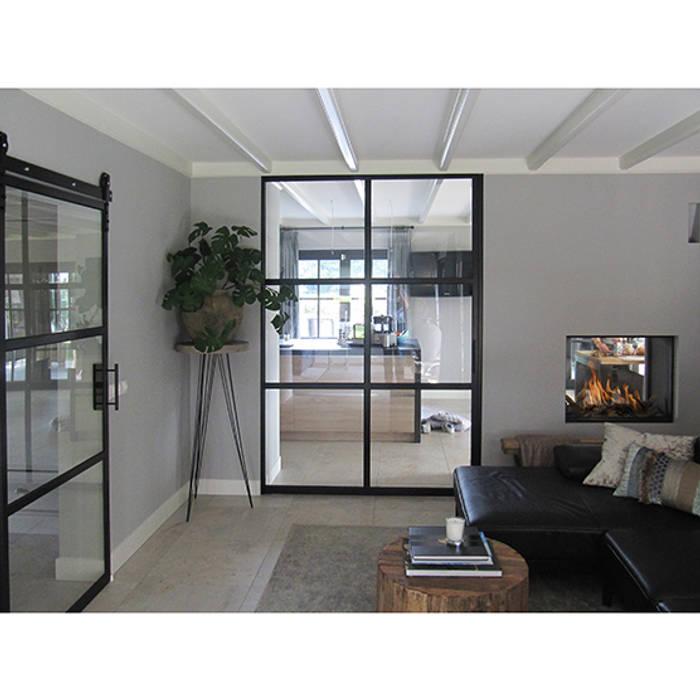 Foto 3 woonkamer:  Woonkamer door Anne-Carien Interieurarchitect, Modern