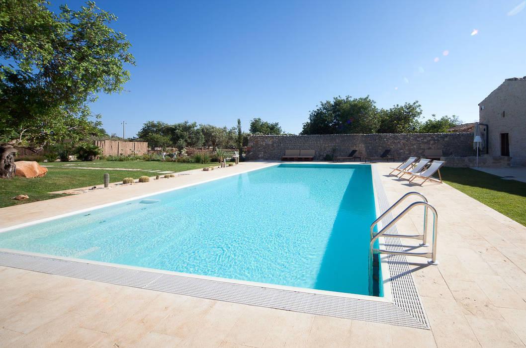 Costruzione piscine interrate piscina in stile di piscine homify - Costruzione piscina interrata ...