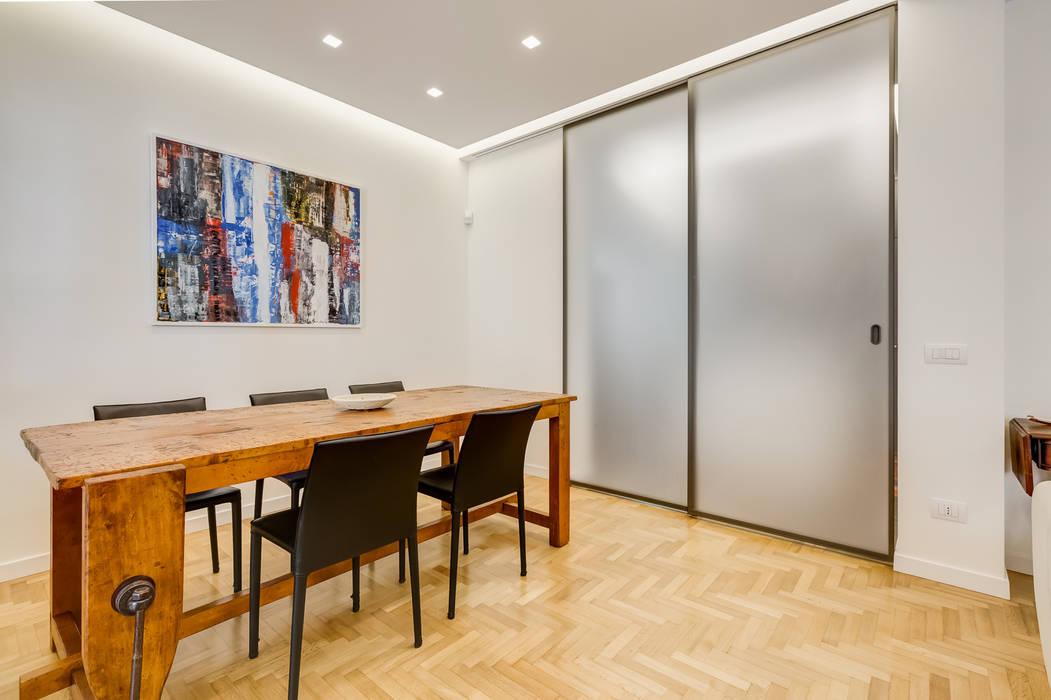 Farnesina minimal design sala da pranzo in stile di ef archidesign homify for Colori casa moderna