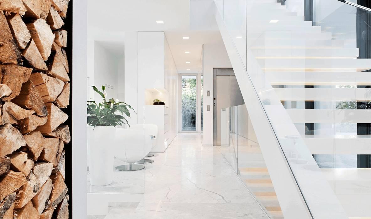 Projekty,  Korytarz, przedpokój zaprojektowane przez monovolume architecture  design,