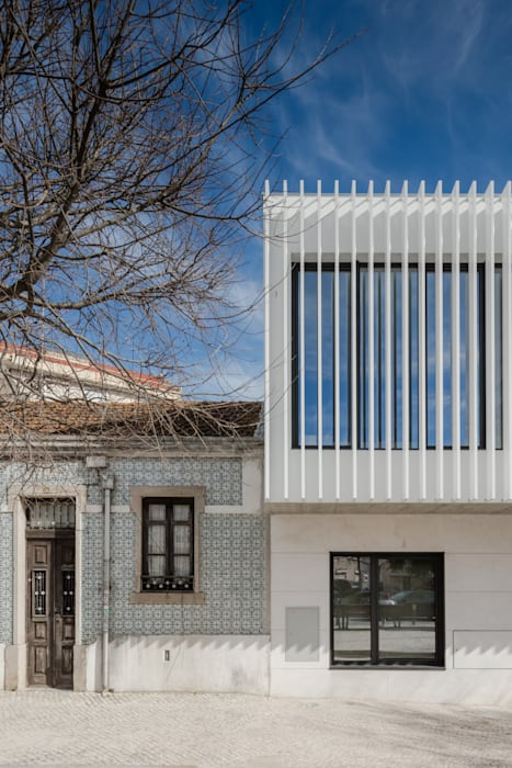 Casas de estilo minimalista de Plano Humano Arquitectos Minimalista Piedra
