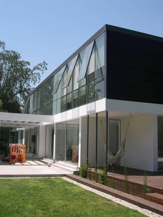 Casa Joullié: Casas de estilo  por Claudia Tidy Arquitectura