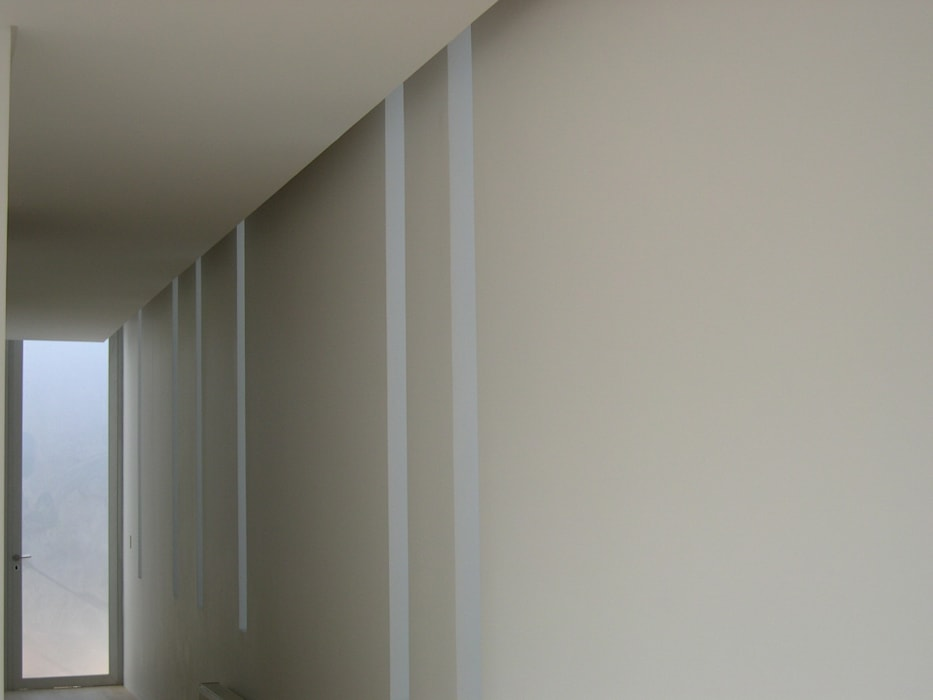 Casa Joullié: Pasillos y hall de entrada de estilo  por Claudia Tidy Arquitectura