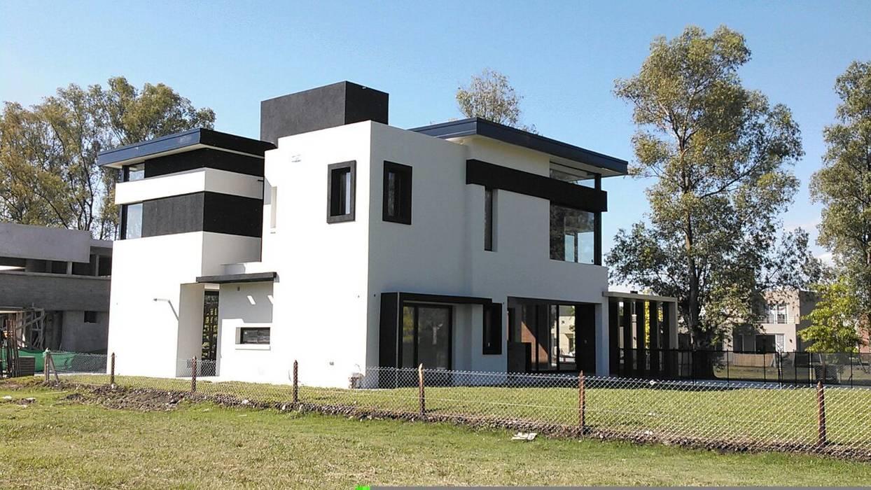 Houses by Grupo PZ, Modern