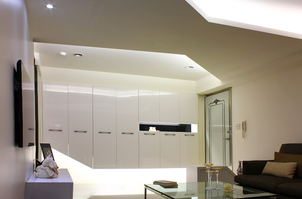 Coigne:  客廳 by 築一國際室內裝修有限公司