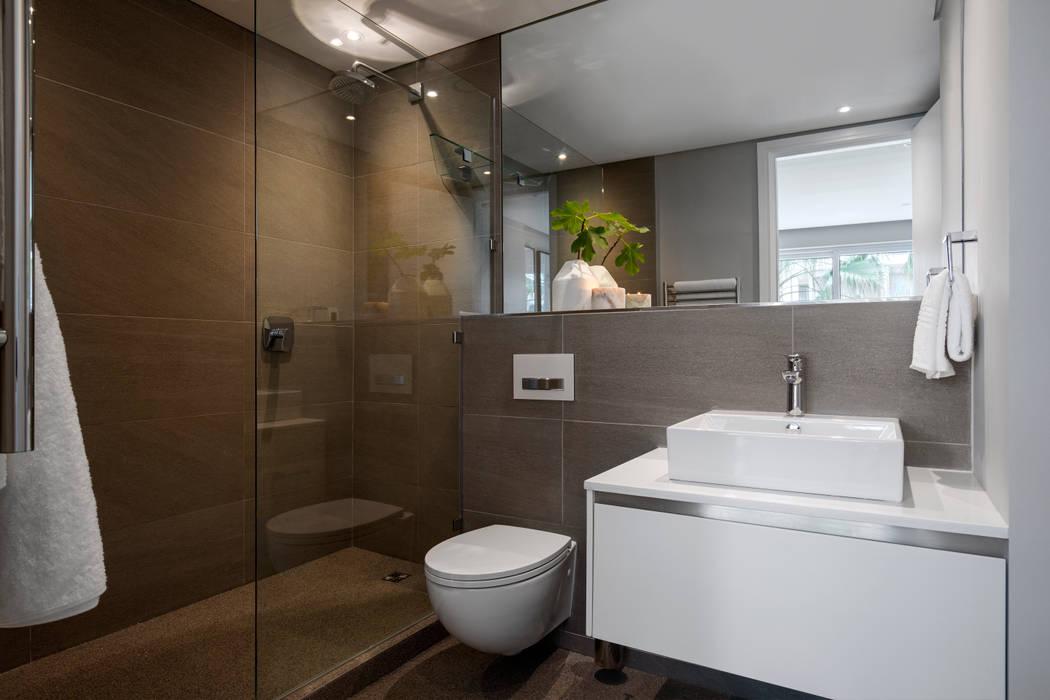 WATERFRON STAY_GULMARN APARTMENTS:  Bathroom by MINC DESIGN STUDIO