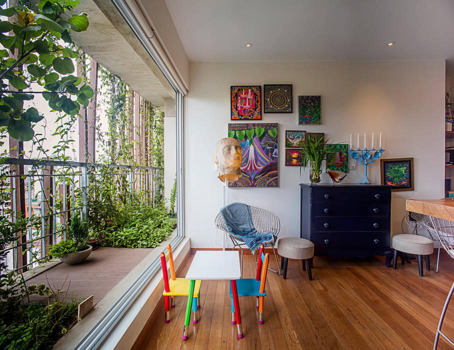 Edificio Madreselva Salas modernas de Vicca Verde Moderno