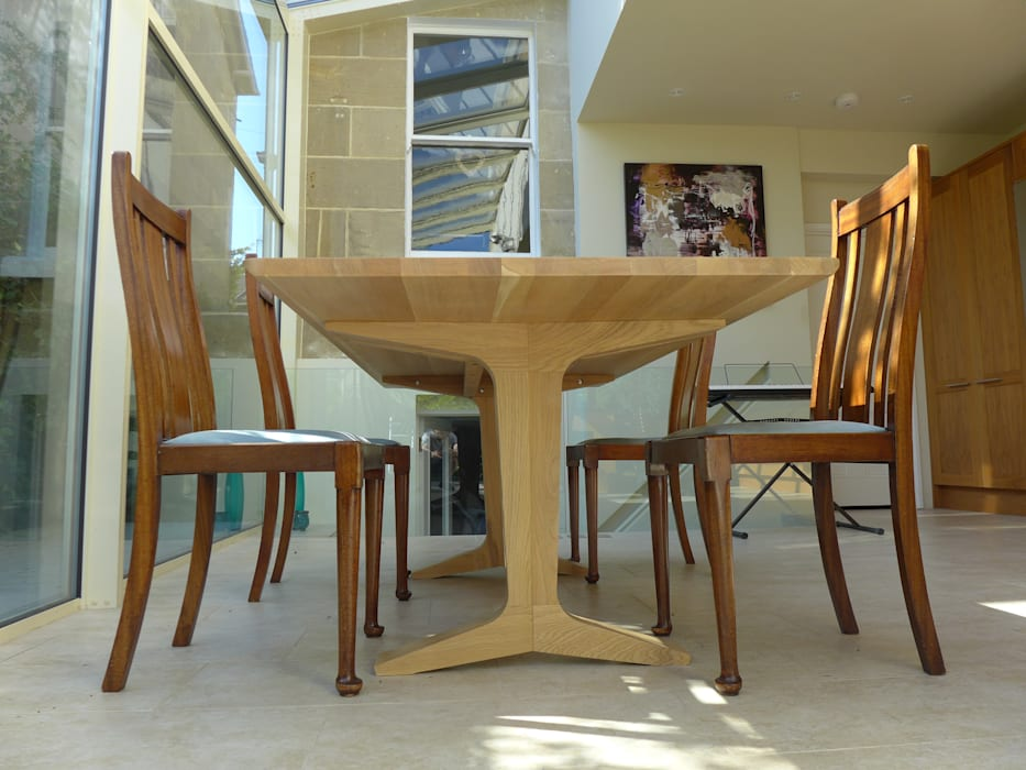 dining area under glass roof:  Dining room by Style Within