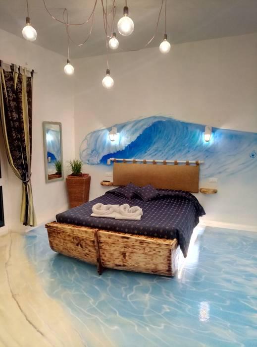 Pavimento in resina effetto mare: Hotel in stile  di Luca Alitini