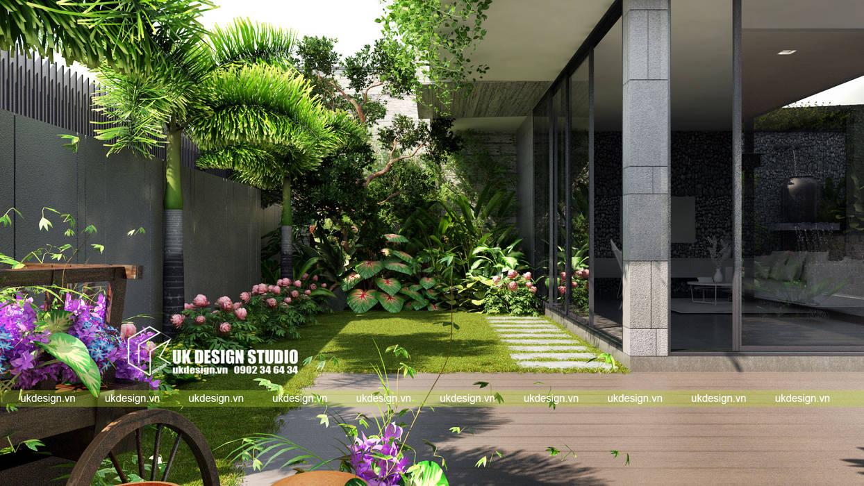 BIỆT THỰ HIỆN ĐẠI SÂN VƯỜN HỒ BƠI:  Biệt thự by UK DESIGN STUDIO - KIẾN TRÚC UK