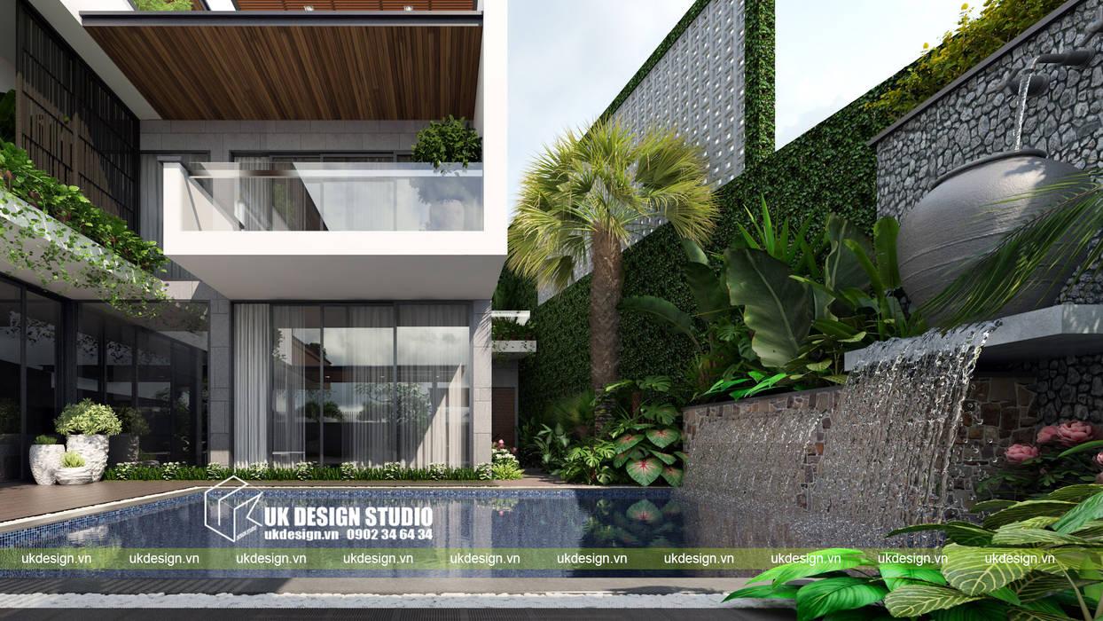 Casas de estilo  de UK DESIGN STUDIO - KIẾN TRÚC UK,