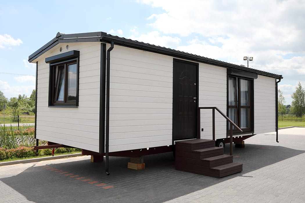 Casas de estilo  por DMK Budownictwo Dariusz Dziuba Sp. K., Mobilne Domki Letniskowe i Całoroczne, Moderno