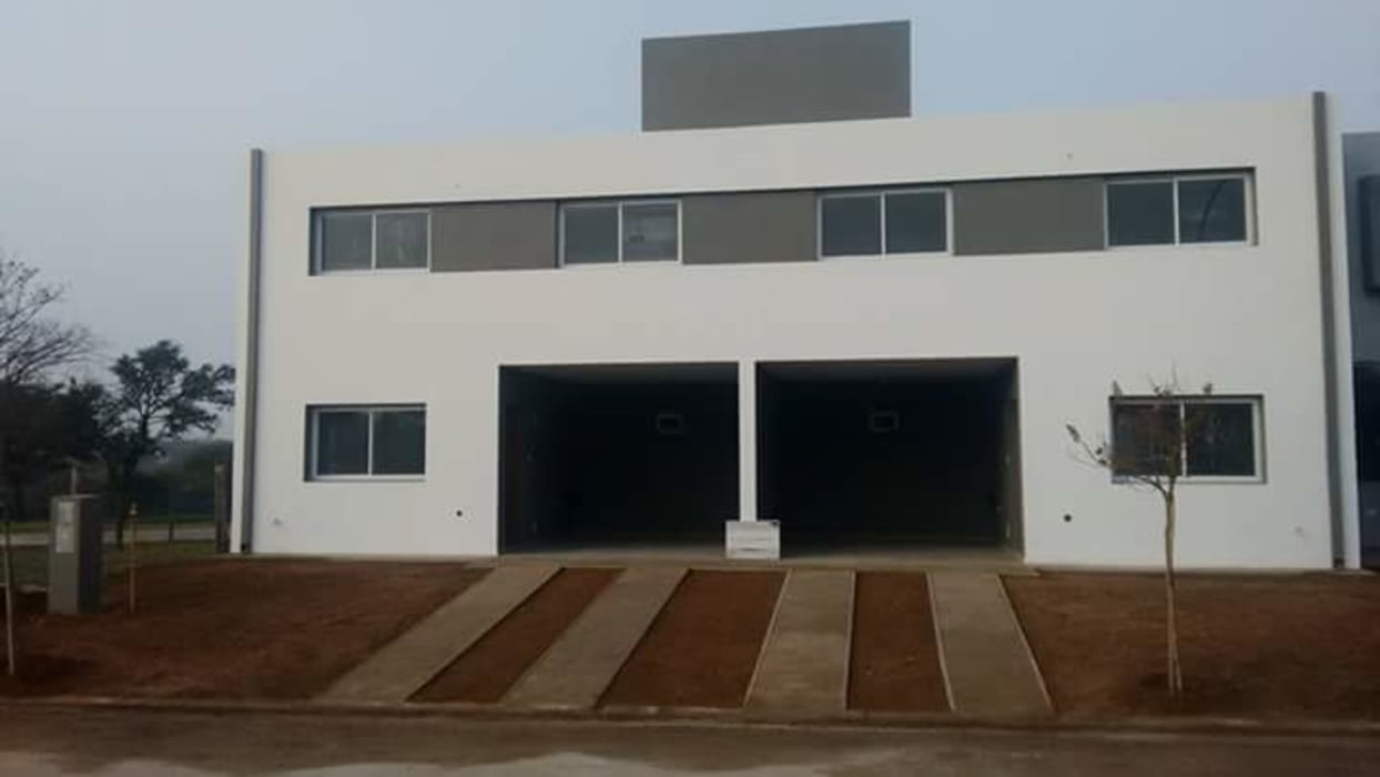 Dúplex NM | Miradores de Manantiales: Casas de estilo moderno por Arquitecto Nicolás Mora