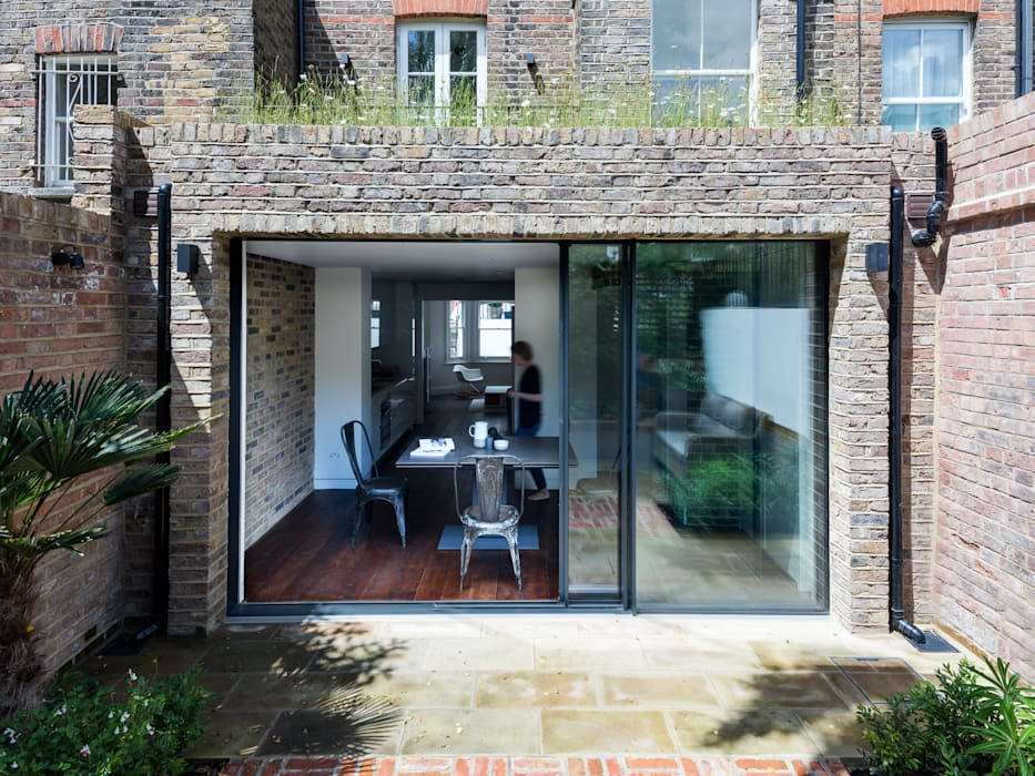 Rear elevation Modern houses by Brosh Architects Modern Bricks