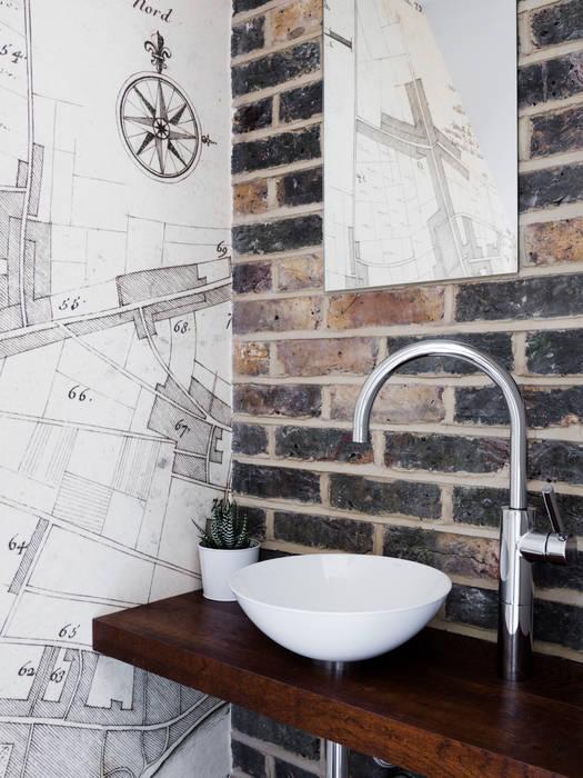 WC: modern Bathroom by Brosh Architects