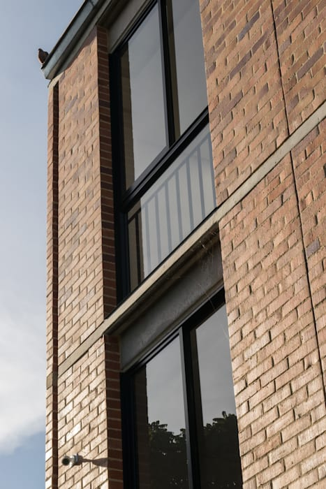 Rumah oleh Ensamble de Arquitectura Integral, Minimalis Batu Bata