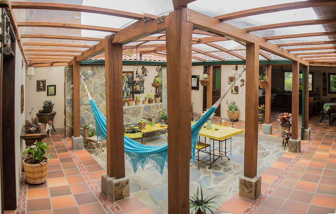 CASA FAGUA de ENSAMBLE de Arquitectura Integral Rural Madera Acabado en madera