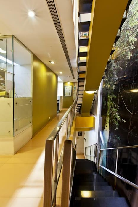 Corridor and Staircase by Studio - Architect Rajesh Patel Consultants P. Ltd Modern