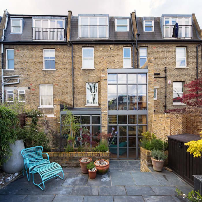 Double height crittall style extension HollandGreen Case eclettiche