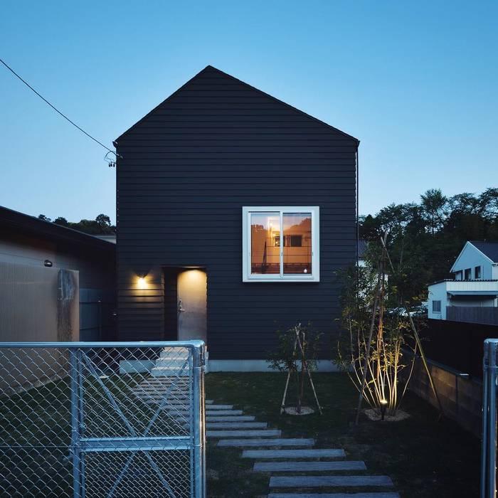 ほどよく自然体でかっこよく暮す家「BROOKLYN HOUSE」 インダストリアルな 家 の オレンジハウス インダストリアル