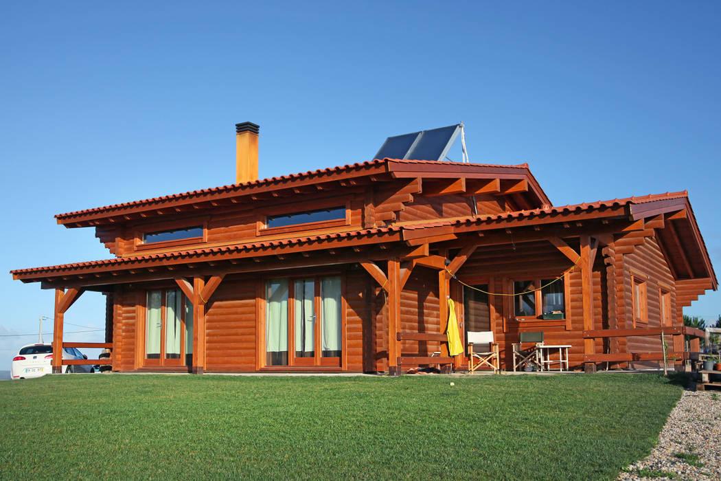 RUSTICASA | Casa unifamiliar | Óbidos: Casas de madeira  por Rusticasa