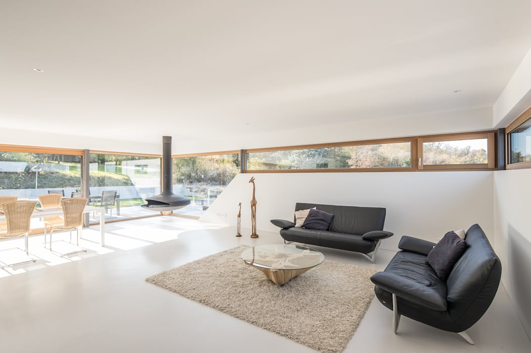 Haus DN:  Wohnzimmer von Henecka Architekten