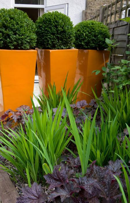 Orange fibreglass planters:  Garden by Earth Designs