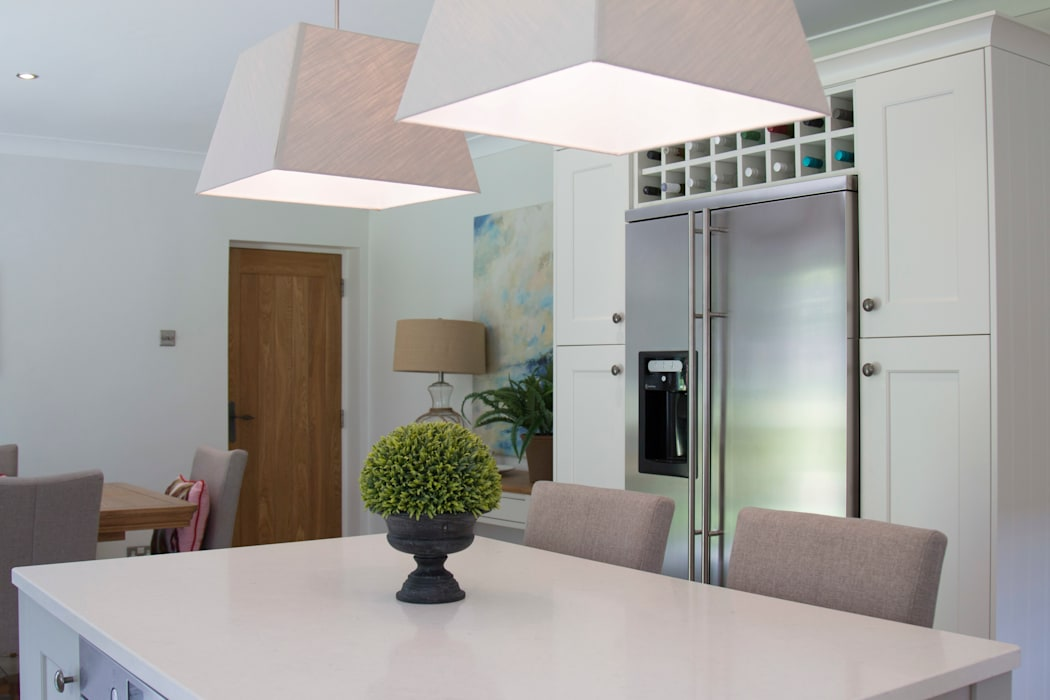 Pendant Lighting is essential above Kitchen Islands:  Built-in kitchens by ADORNAS KITCHENS