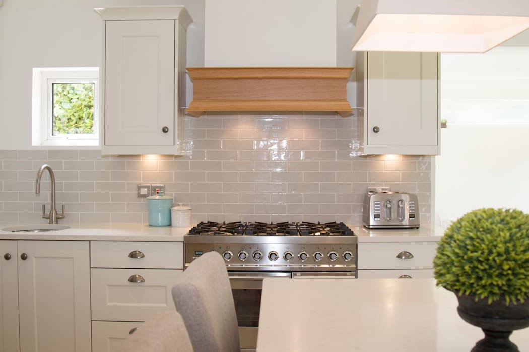 A bespoke cooker hood was added to create a colonial look:  Built-in kitchens by ADORNAS KITCHENS