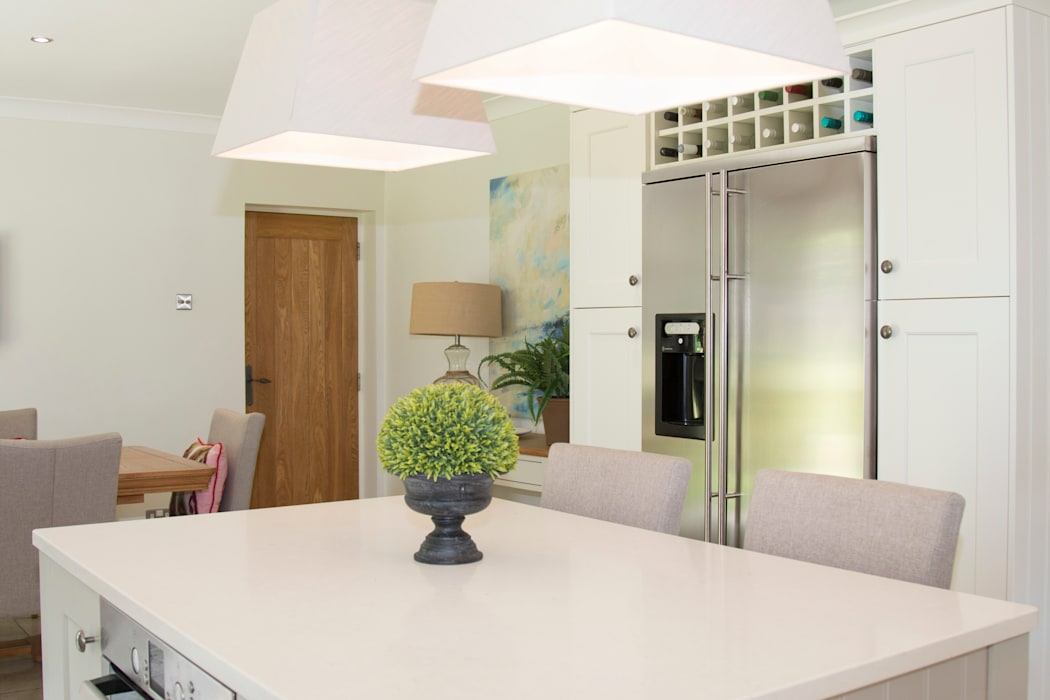 Stainless Steel appliances are a contrast against the painted cabinets:  Built-in kitchens by ADORNAS KITCHENS