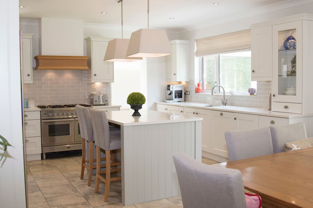 Choosing a neutral palette can be timeless.:  Kitchen by ADORNAS KITCHENS