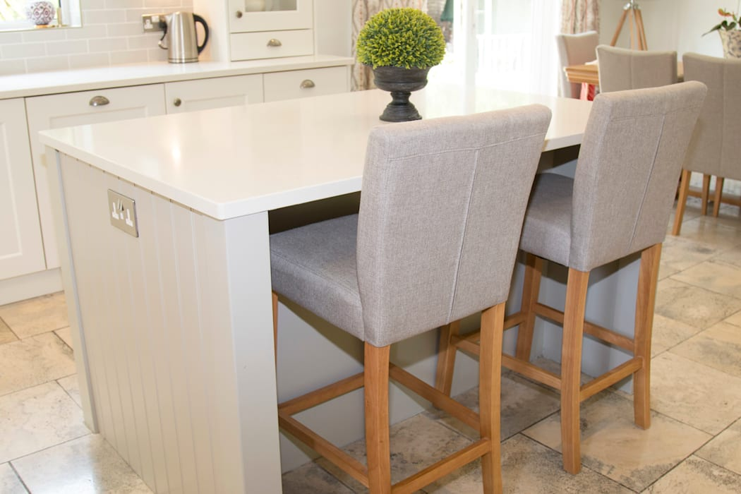 Islands provide flexible seating areas:  Built-in kitchens by ADORNAS KITCHENS
