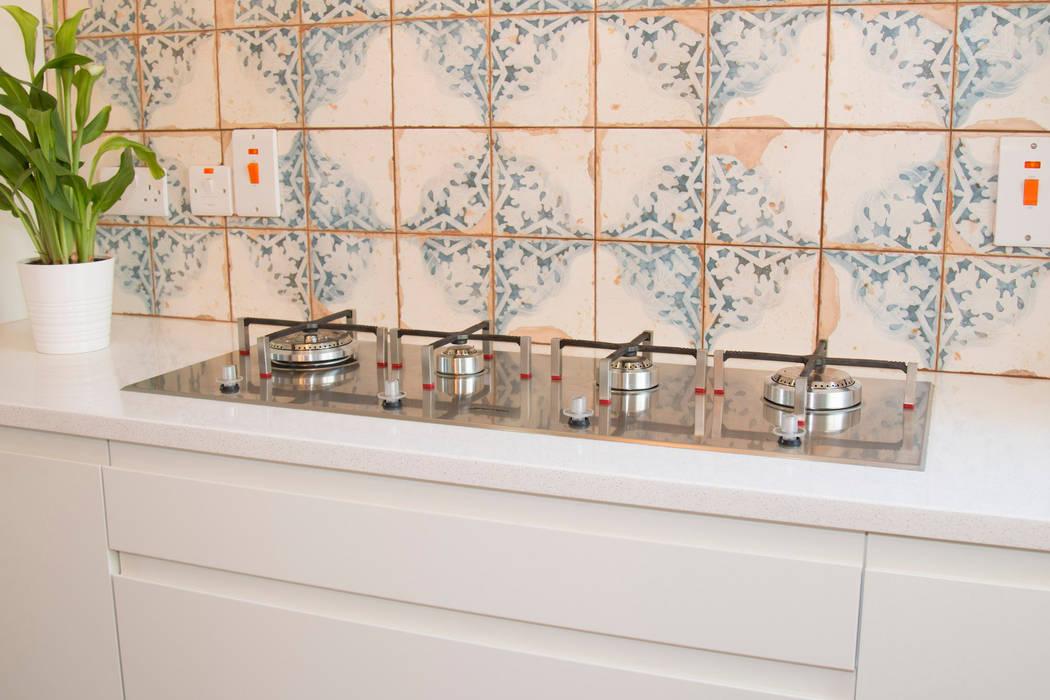 Striking Ceramic Tiles, and a modern SMEG hob:  Built-in kitchens by ADORNAS KITCHENS