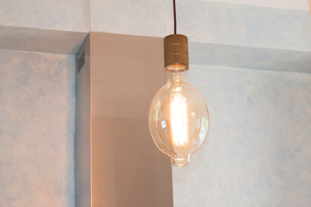 Filament light bulbs add atmosphere:  Built-in kitchens by ADORNAS KITCHENS