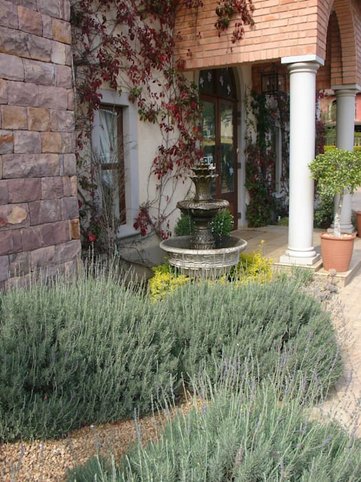 Tuscany style garden and fountain: modern Garden by Town and Country Gardens