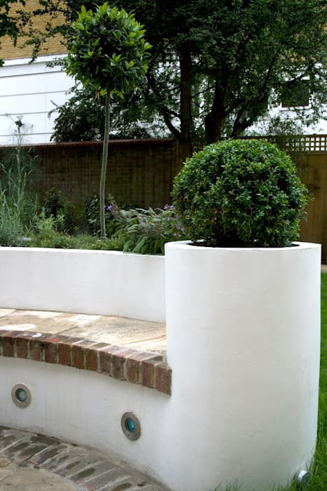 Box ball in planter:  Garden by Earth Designs