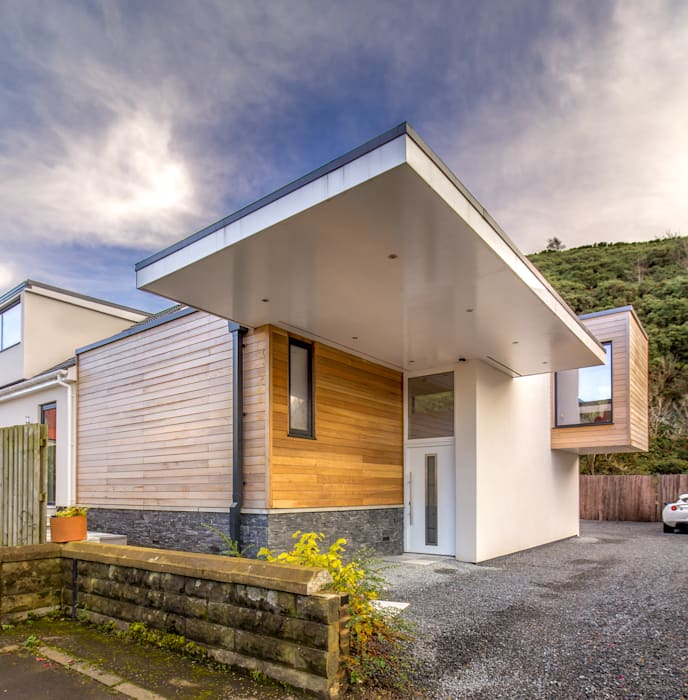 Cantilevered Entrance Canopy :  Detached home by Capital A Architecture