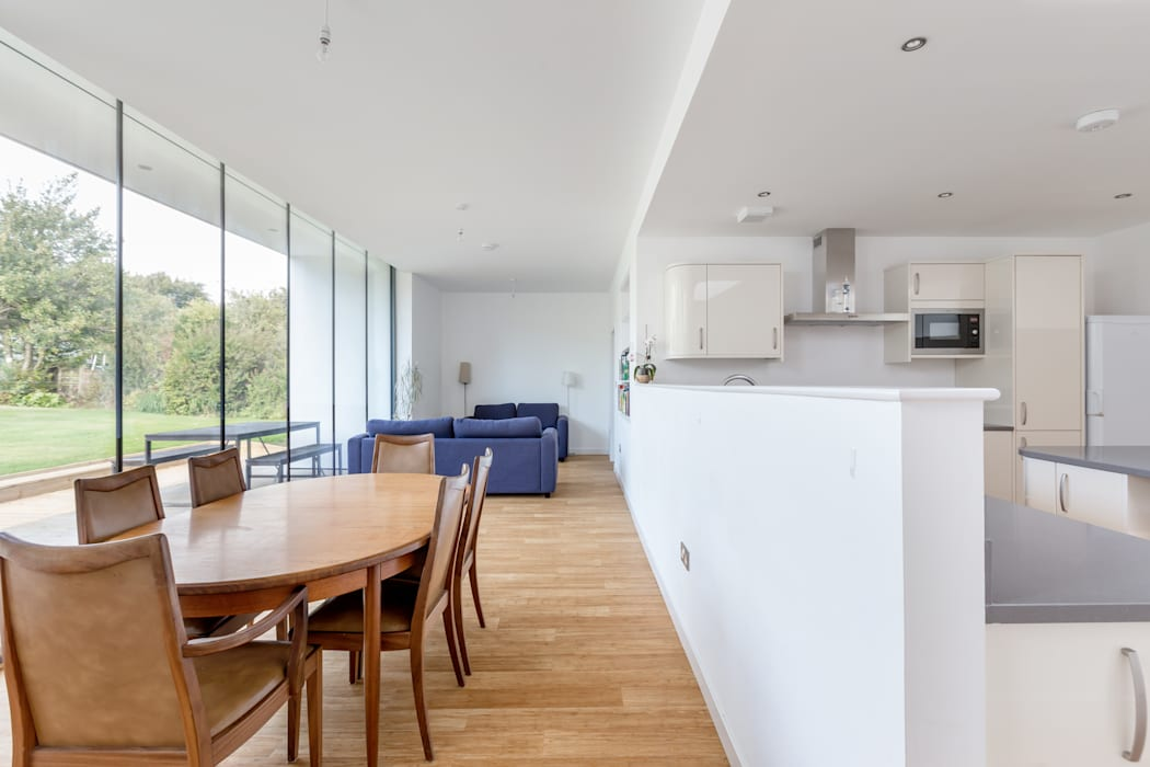 Open Plan Kitchen / Dining:  Built-in kitchens by Capital A Architecture