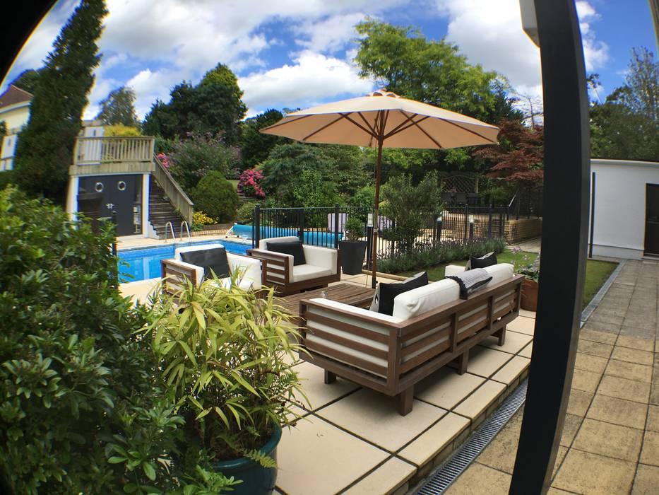 Garden with pool Modern garden by KD DESIGNS LTD Modern