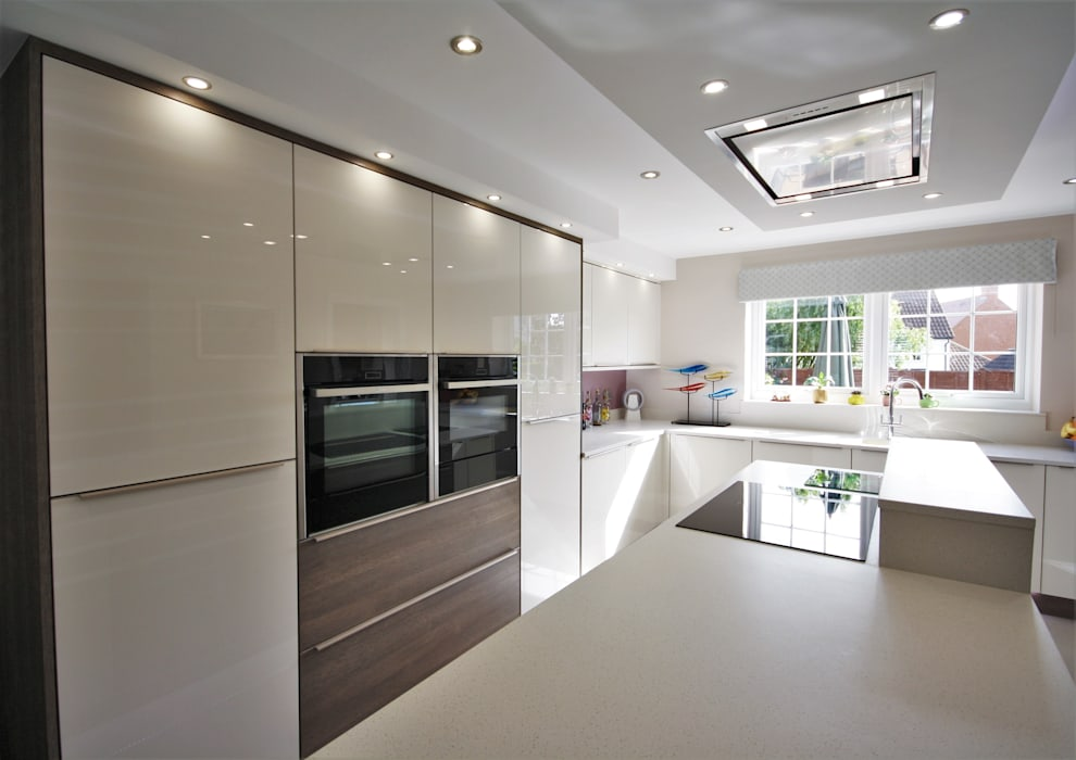 Acrylic gloss Ivory kitchen with Wood effect panelling:  Built-in kitchens by Kitchencraft