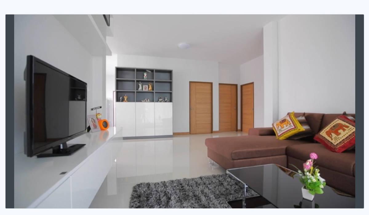 บ้านสวยวิวดอยสุเทพ ใกล้ ม.ช.:  ห้องนั่งเล่น by บริษัท ถาวรเจริญทรัพย์ จำกัด